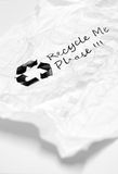Crumpled used paper with recycle sign Royalty Free Stock Images