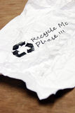 Crumpled used paper with recycle sign Royalty Free Stock Photography