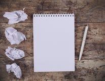 Crumpled wads, notebook Stock Photos