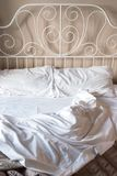 Crumpled white bedclothes. Vintage bed. Stock Photos