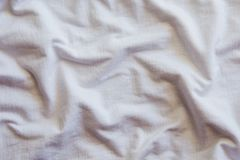 Crumpled white Cotton Fabric Texture. royalty free stock image