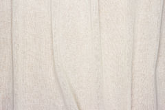 Crumpled white cream color Fabric texture background Stock Image