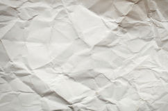 Crumpled  white paper card on beige background Royalty Free Stock Photos