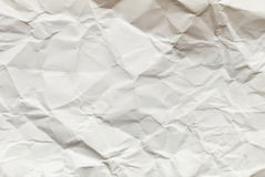 Crumpled  white paper card on beige background Royalty Free Stock Photography