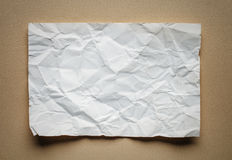 Crumpled  white paper card on beige background Royalty Free Stock Image