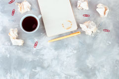 Crumpled white paper, notebook and cup of coffee Stock Photos