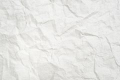 Crumpled white paper. Old crumpled sheet of white paper stock photography
