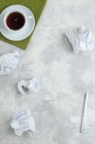 Crumpled white paper over concrete background Royalty Free Stock Photo