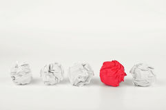 Crumpled white paper with red ball of crumpled paper Stock Image
