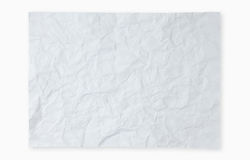 Crumpled white paper on white background Stock Images