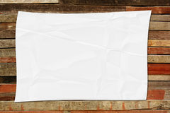 Crumpled white paper on wood Royalty Free Stock Image