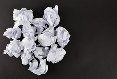 Crumpled white papers isolated on black. Stack of crumpled white papers isolated on black royalty free stock photos