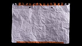 Crumpled white sheet of paper. Stop motion animation: unwrapping and wrapping blank sheet of paper on black background. Crumpled piece of white paper exercise stock footage