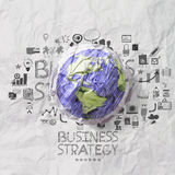 Crumpled world and hand drawn business straegy on crumpled paper Royalty Free Stock Photos
