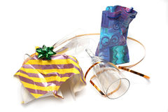 Crumpled wrapping and empty glasses Stock Photo