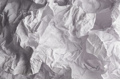 Crumpled wrinkled wavy grey paper texture, abstract polygon background. Stock Photo