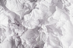 Crumpled wrinkled wavy grey paper texture, abstract polygon background. Stock Image