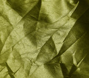 Crumpled yellow fabric background Stock Photos