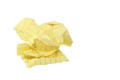 Crumpled Yellow Legal Paper Frustration Concept. A wadded sheet of yellow legal paper isolated on a white background Stock Images