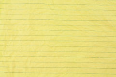 Crumpled yellow lined paper Stock Photo