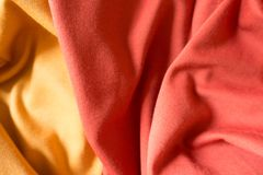 Crumpled yellow and orange jersey fabric. Crumpled yellow and orange simple jersey fabric Stock Image