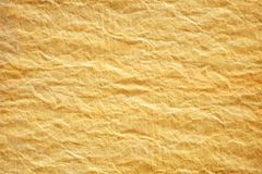 Crumpled Yellow Paper. Texture. Crumpled Yellow-Orange Paper Background royalty free stock images