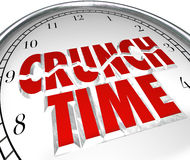 Crunch Time Clock Hurry Rush Deadline Final Moment. The words Crunch Time on a clock to illustrate a rush to beat a deadline, or countdown to the final moments Stock Image