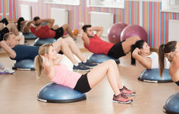 Crunches on bosu Royalty Free Stock Photography
