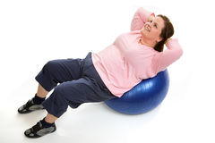 Crunches on Pilates Ball Royalty Free Stock Photo