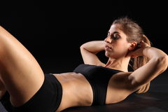 Crunches by young sexy woman in exercise workout Stock Photography