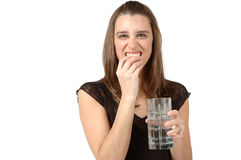 Crunching on Ice. Woman eats ice and makes crunching noise Royalty Free Stock Image