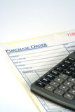 Crunching Numbers. Purchase Order receipt and calculator Stock Photos