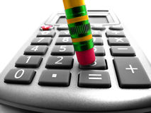 Crunching numbers on Calculator Stock Photo