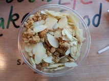 Crunchy almond flakes cereal. Simple bowl with almond flakes and crunchy cereal on wooden table stock photography
