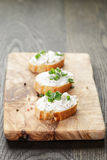 Crunchy baguette slices with cream cheese and Stock Images