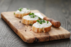 Crunchy baguette slices with cream cheese and Royalty Free Stock Photo