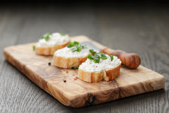 Crunchy baguette slices with cream cheese and Royalty Free Stock Photography