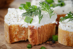 Crunchy baguette slices with cream cheese and Royalty Free Stock Image