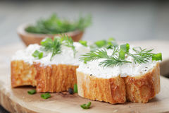 Crunchy baguette slices with cream cheese and Royalty Free Stock Photos