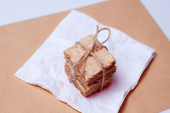 Crunchy biscuits with rosemary. On a paper napkin Stock Photography