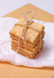 Crunchy biscuits with rosemary. On a paper napkin Stock Images