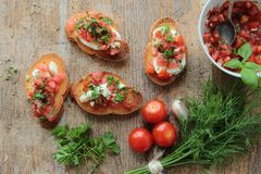 Crunchy bruschettas with fresh vegetables Stock Photos