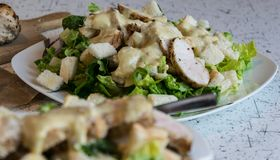 Excellent caesar salad with roasted pastry and chicken, sprinkled with parmesan cheese Stock Photos