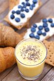 Crunchy cereal breakfast, banana smoothie. stock image