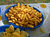 Crunchy cheese snacks puffs doodles in a blue bowl Royalty Free Stock Photo