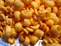 Crunchy cheese snacks puffs doodles in a serving bowl Royalty Free Stock Images