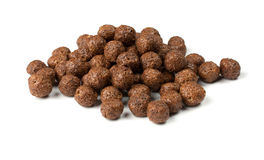 Crunchy chocolate balls. On a white background royalty free stock photo