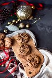 Crunchy christmas chocolate cookies on wooden board and dark concrete table. View from the top royalty free stock images