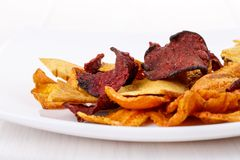 Crunchy colorful organic vegetable chips royalty free stock image