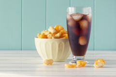 Crunchy corn snacks and cola Royalty Free Stock Photos